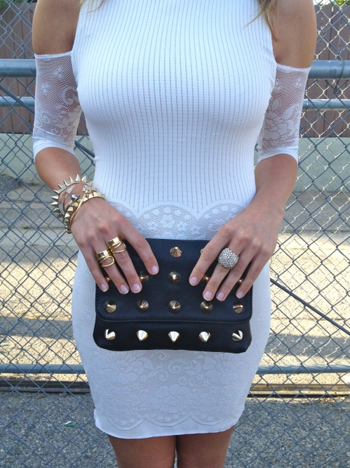 clutch and gold jewelry